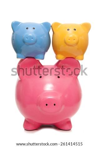 balancing your finances piggy banks cutut - stock photo