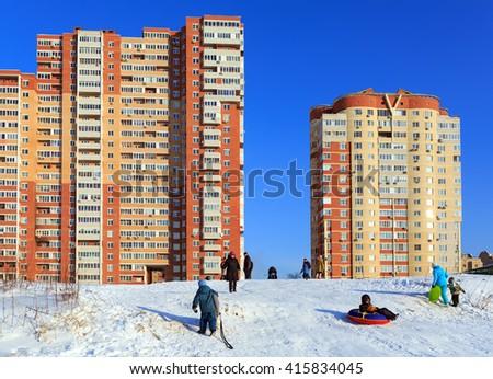 BALASHIKHA, RUSSIA - JANUARY, 21. Winter activities of residents of new buildings, built on the banks of the Pekhorka river on January 21, 2016. Balashikha, Moscow region. Russia. - stock photo