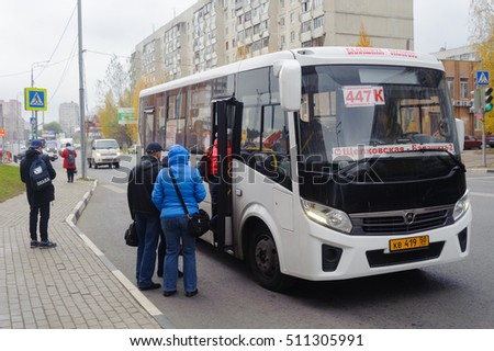 BALASHIKHA, RUSSIA - OCTOBER 28: Passengers entering into bus in Sverdlov Street on October 28, 2016 in Balashikha. Balashikha city is located Moscow.