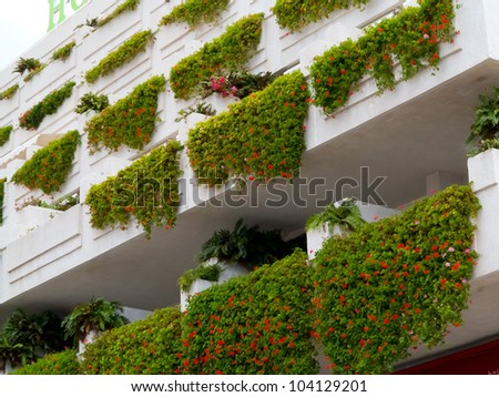 Balconies decorated with plants and flowers - stock photo