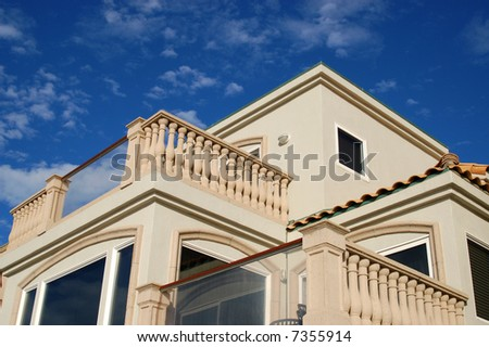 Balconies of beach-front vacation rental property against a blue sky; Mission Beach; San Diego, California - stock photo