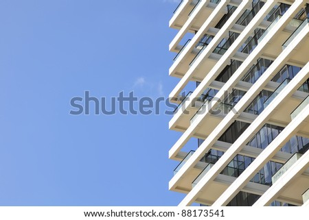 Balconies of modern hotel on the blue sky background - stock photo
