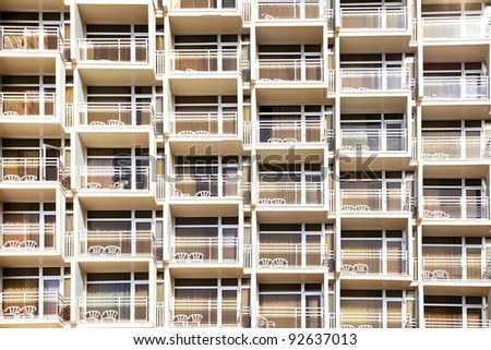 Balconies of modern hotel with white beach chaise - stock photo