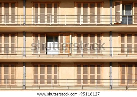 Balconies with a shuttered and open windows of the typical mediterranean modern building - stock photo