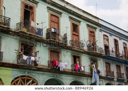 Balconies with washing in downtown Havana - stock photo