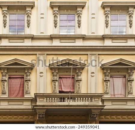 Balcony and windows on an elegant building in Bologna, Italy - stock photo