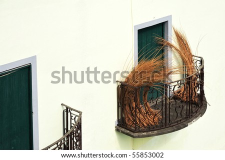 Balcony at old house in Madeira with package of wicker - stock photo