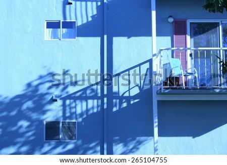 Balcony, blue building, California. - stock photo