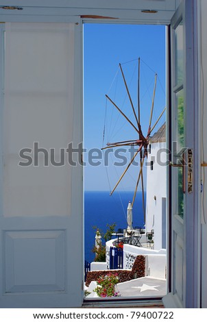 Balcony door with a great view on Santorini island, Greece - stock photo