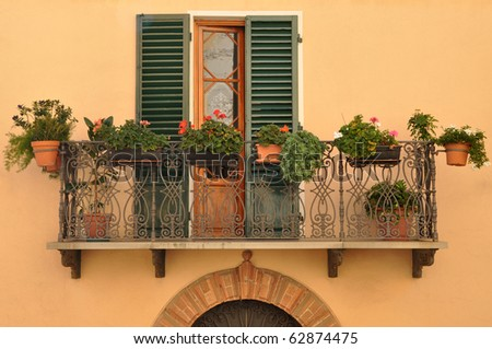 Balcony full of flowers. Tuscany, Italy - stock photo