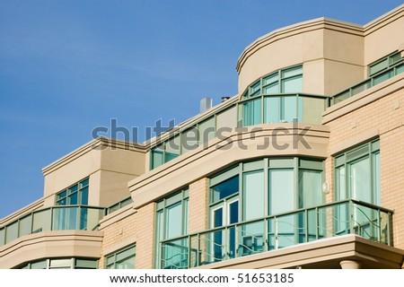 balcony , modern condominium building glass background - stock photo