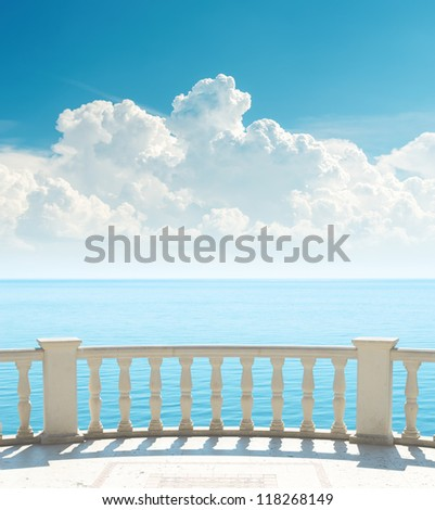 balcony near sea and clouds over it - stock photo