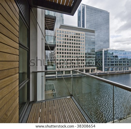 balcony of a contemporary development with city and dock view - stock photo