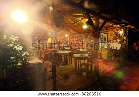 Balcony of a restaurant, traditional folklore style. - stock photo