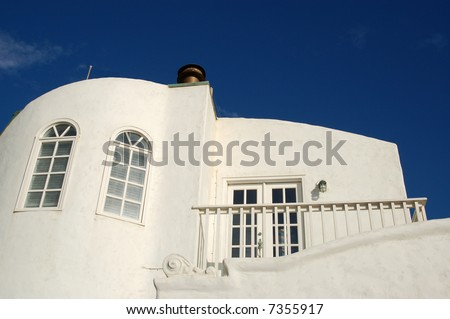 Balcony of a white beach-front vacation rental property against a blue sky; Mission Beach; San Diego, California - stock photo