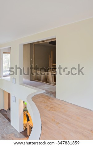 Balcony of living room interior renovation with unfinished house part - stock photo