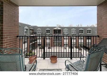 Balcony overlooking courtyard - stock photo