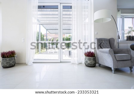 Balcony window in the living room with garden view - stock photo