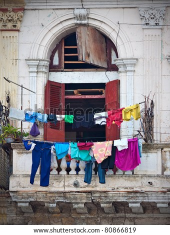 Balcony with clothes in an old building in Havana - stock photo