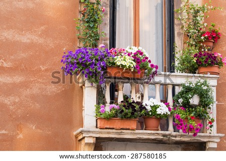 Balcony with colorful flowers - stock photo