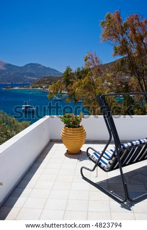 Balcony with swing-sofa and with seaview - stock photo