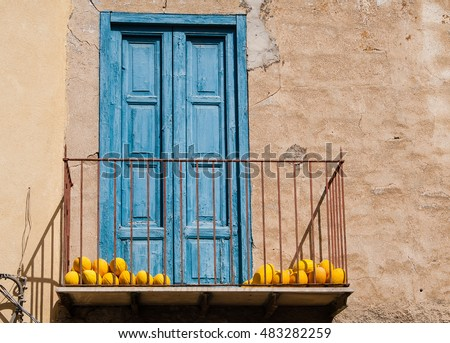 Balcony with yellow melons. Sicily. Italy
