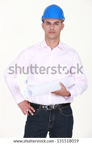 Bald architect stood with plans under arm - stock photo
