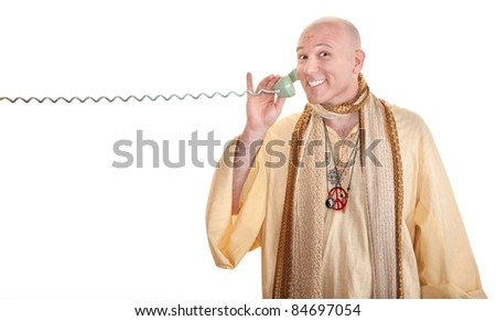 Bald Caucasian monk grins on phone call over white background