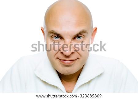 Bald evil grinning man. Isolated on white. Studio - stock photo