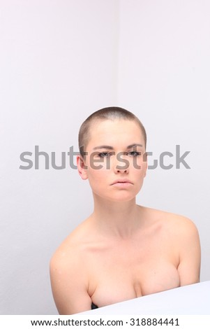 bald half naked girl studio portrait
