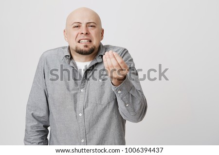 Bald Handsome Bearded Man Looking Angry Showing Italian Gesture Over White  Background. Private Businessman Is