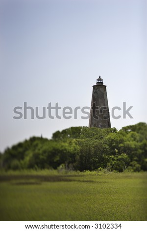 Bald Head Island lighthouse on Bald Head Island, North Carolina. - stock photo