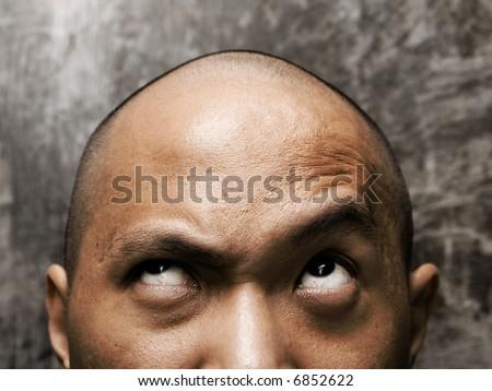 bald headed man with confuse expression - stock photo