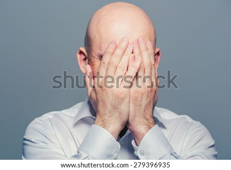 Bald man face closed hands  - stock photo