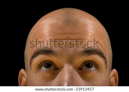 Bald man head looking up thinking, with focus on eyes