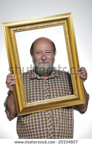 Bald man holding picture frame isolated on white background