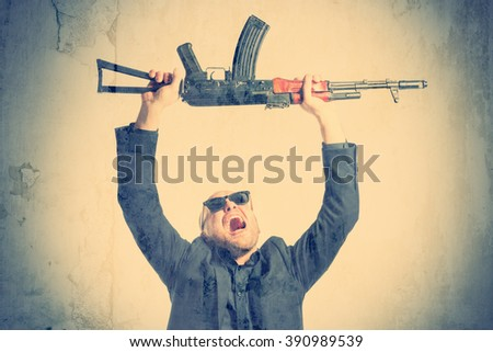 Bald man in a gray suit and sunglasses screaming with raised arms over his head against the background of soeny. Toned - stock photo