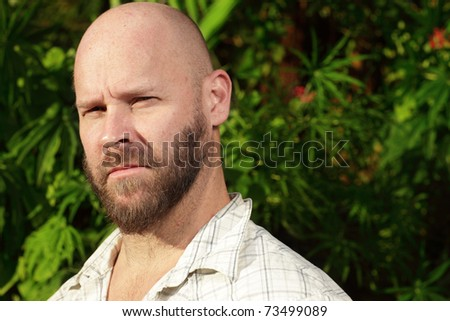 Bald man in a nature setting - stock photo