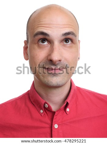Bald man looking up isolated on a white background