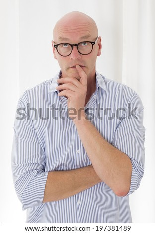 bald man looking up the sky thoughtfully - stock photo