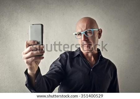 Bald man's funny expression
