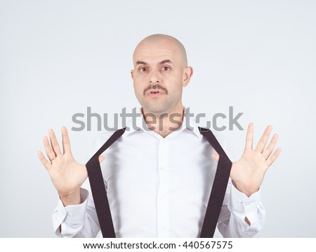 bald man shrugging shoulders I don't know gesture Isolated.  Human body language.  - stock photo