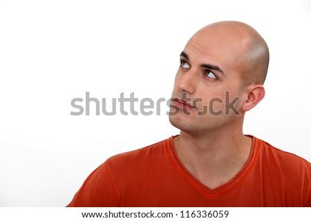 Bald man thinking - stock photo