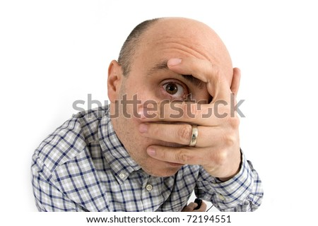 Bald man with hand over his eye. - stock photo