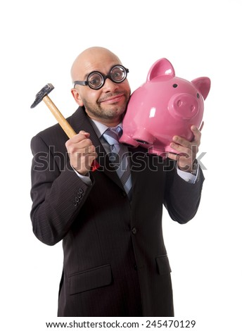 bald nerdy businessman with geek glasses holding pink piggybank on his hand ready to break piggy bank with hammer and take money out isolated on white background - stock photo