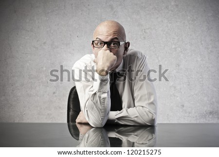 Bald office worker reflecting with a hand over her mouth - stock photo