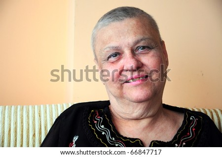 bald (short hair cut) woman - stock photo