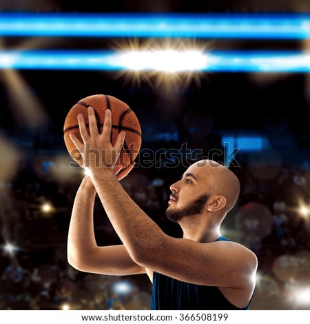 Bald sportsman playing basketball and throws a ball.  Basketball game. Sportsman plays basketball.