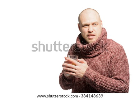 Bald unshaven man in sweater holding a cup of drink. Isolated