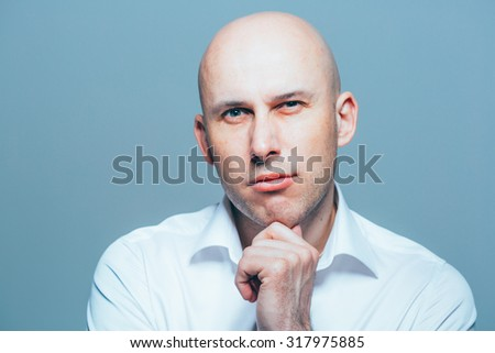 bald young man portrait close-up - stock photo